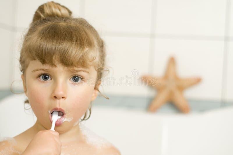 Little girl brushing teeth stock image
