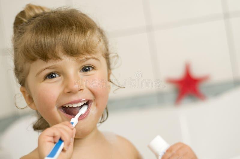 Little girl brushing teeth royalty free stock photos