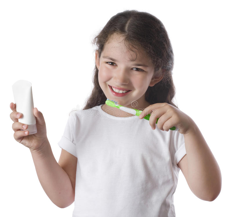 Little girl brushing teeth, isolated royalty free stock photography