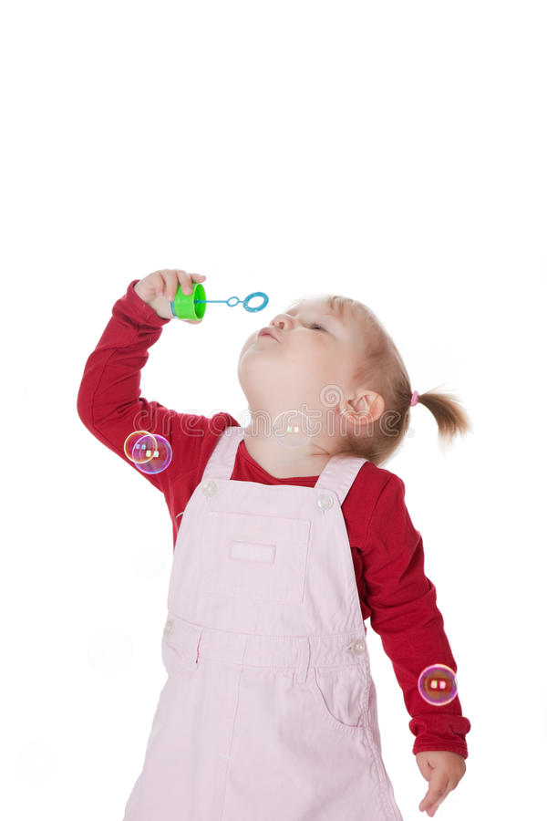 Little girl with bubbles. The little girl with bubbles royalty free stock photo