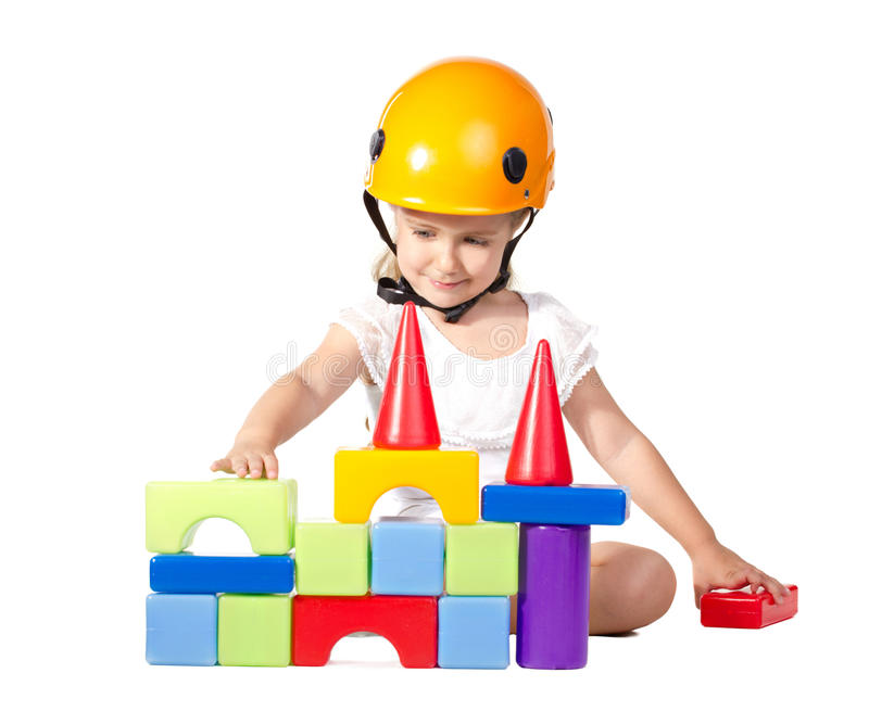 Little girl building a house royalty free stock photo