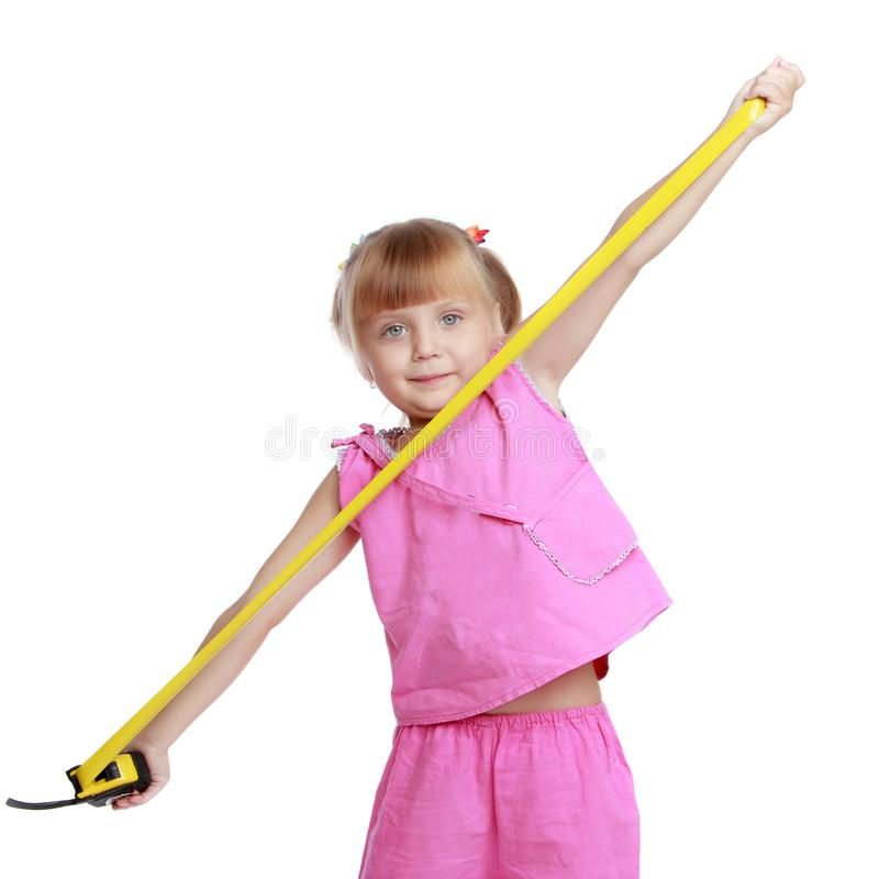 Little girl with a building tape measure. stock photography