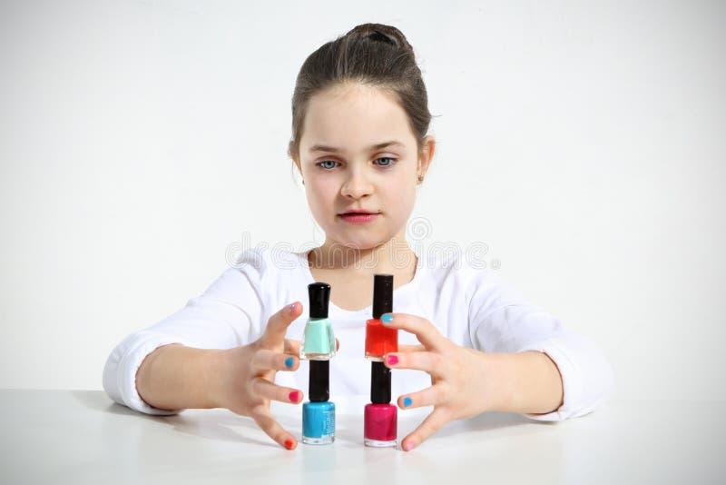 Little girl builds stock image