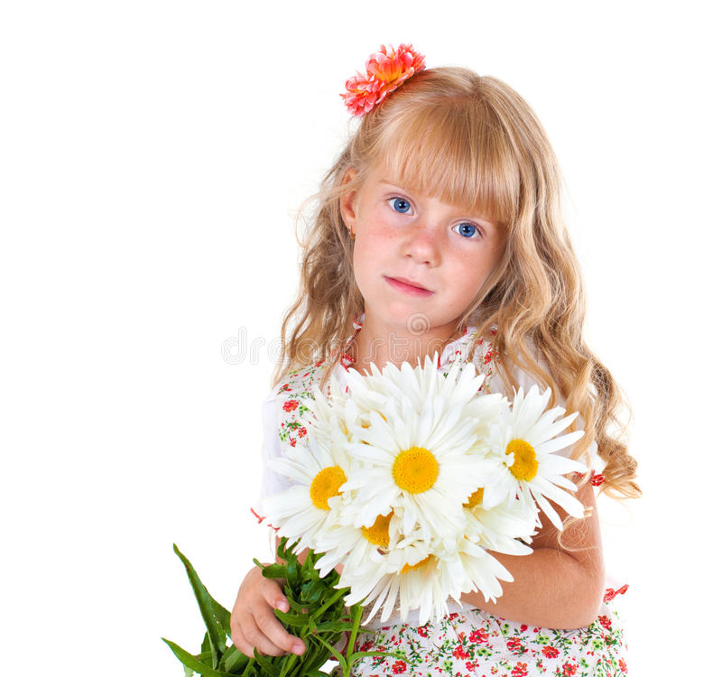 Little girl with a bunch of chamomile stock image