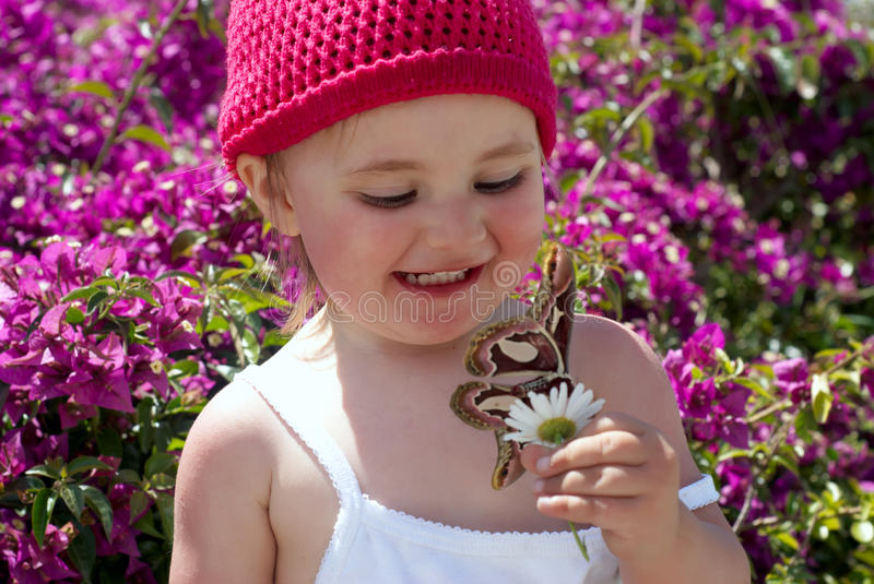 The little girl with butterfly stock images
