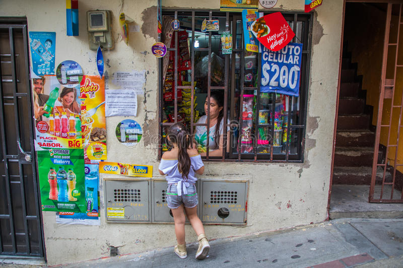 Little girl buying candy at street side store royalty free stock photo