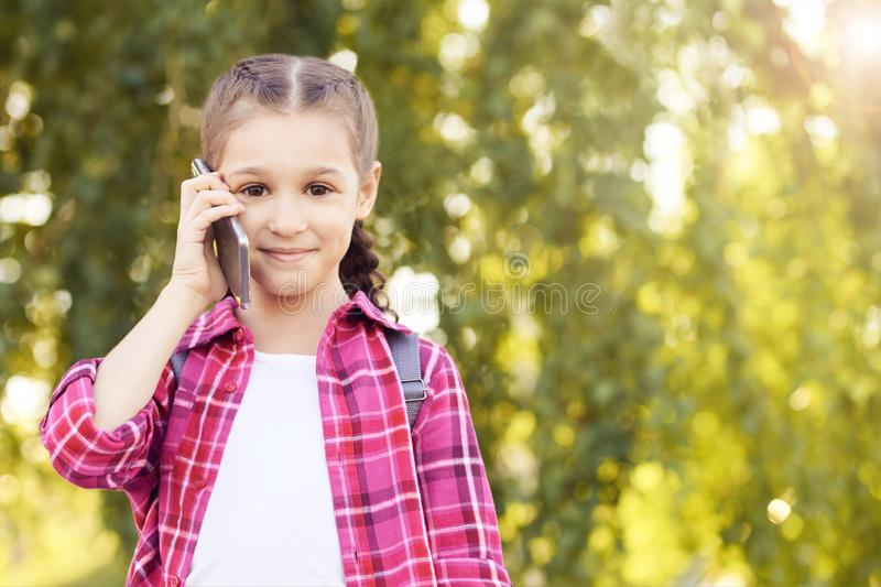 Little girl calling and chat telephony. Busy telephone. Watching royalty free stock images