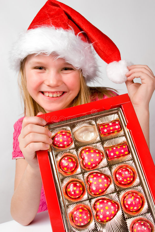 Download Little Girl With Candies In Box Stock Image - Image: 7587955