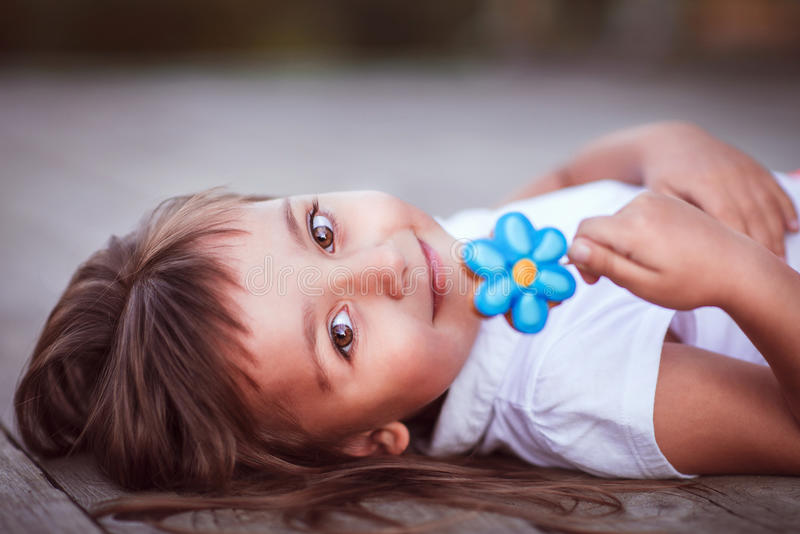 Little girl with candy stock images