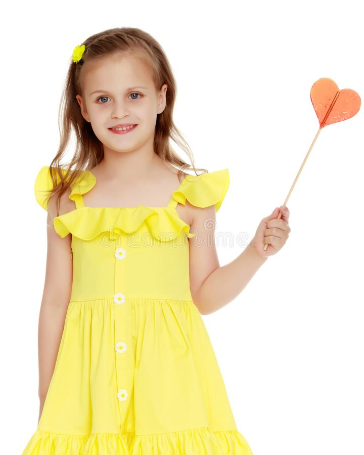 Little girl with a candy on a stick. The concept of sweets, festive mood, birthday, happiness, child, Happy childhood. Isolated over white background stock image
