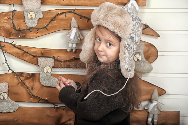 Little girl in a cap. With earflaps stock photography