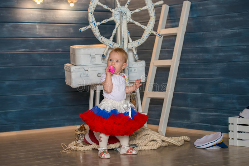 Little girl the captain of the ship royalty free stock images