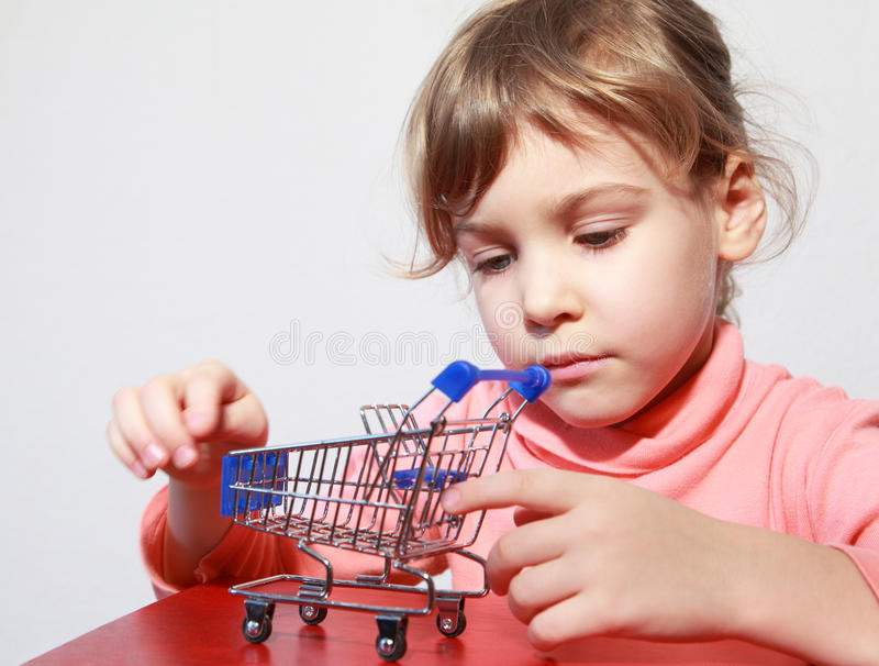 Download Little Girl Care Play With Toy Shopping Trolley Stock Photo - Image: 19719138