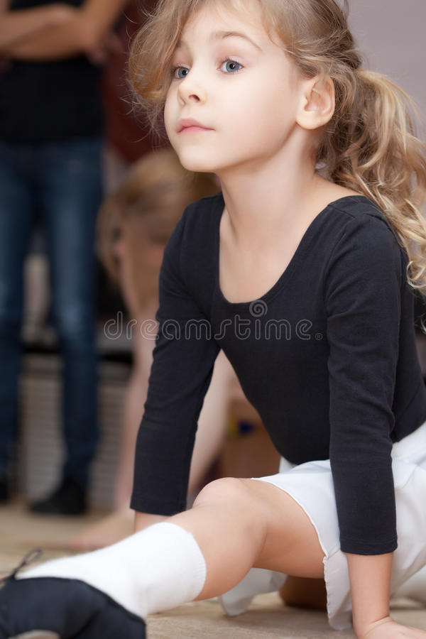Little girl carries out exercise royalty free stock image
