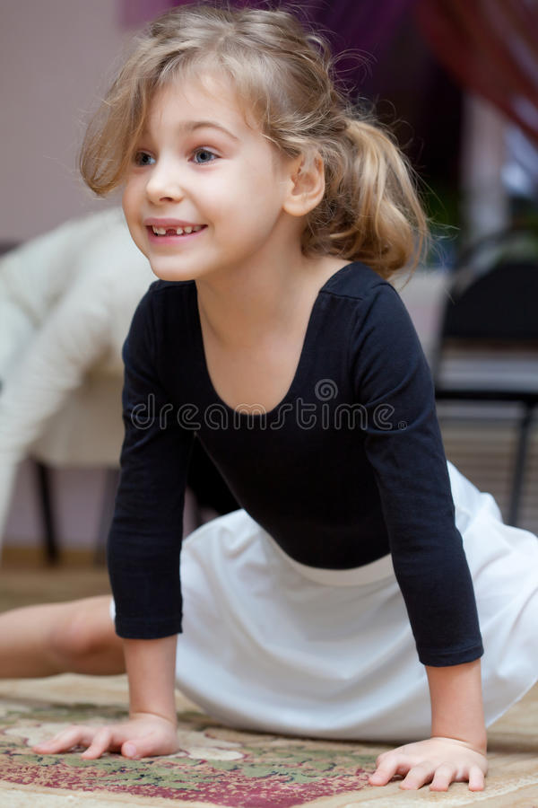 Little girl carries out exercise