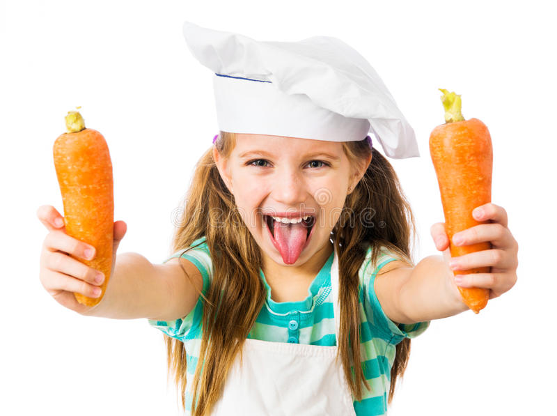 Little girl with carrot royalty free stock images