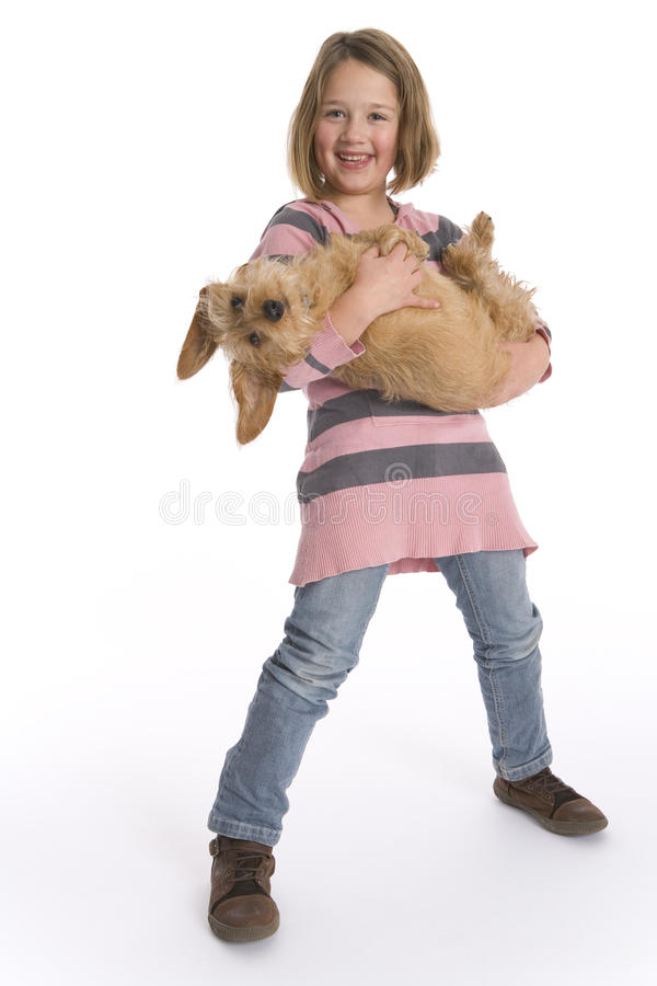 Little Girl Carrying Pet Dog Stock Images