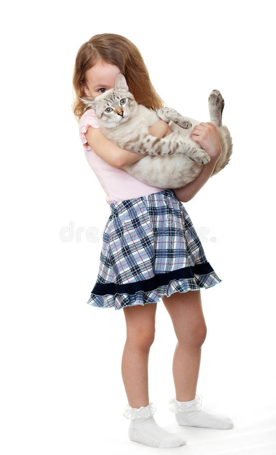 Little girl with cat. Little girl with a cat stock images