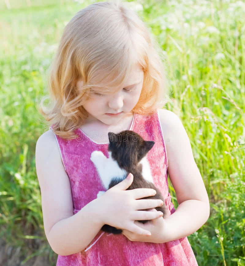 Download Little girl with cat stock photo. Image of happy, park - 19976072