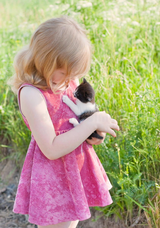 Download Little girl with cat stock photo. Image of park, child - 19976144