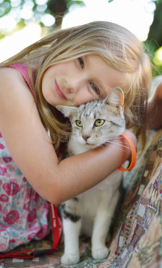 Little girl with cat. Outdoors royalty free stock photo