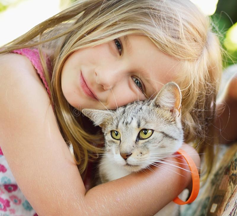 Little girl with cat. Outdoors stock image