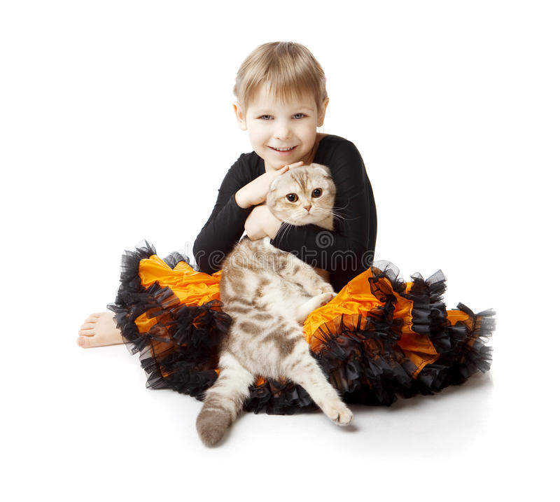 Little girl with a cat on a white background. The image of a little girl with a cat on a white background royalty free stock photo
