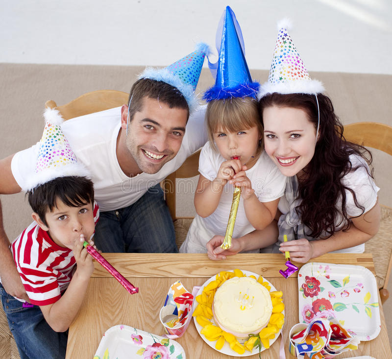 Little girl celebrating her birthday with family. High angle of little girl celebrating her birthday with her family royalty free stock photography