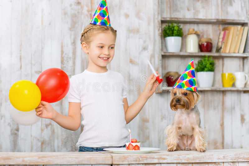 Little girl celebrating her pets birthday. royalty free stock images