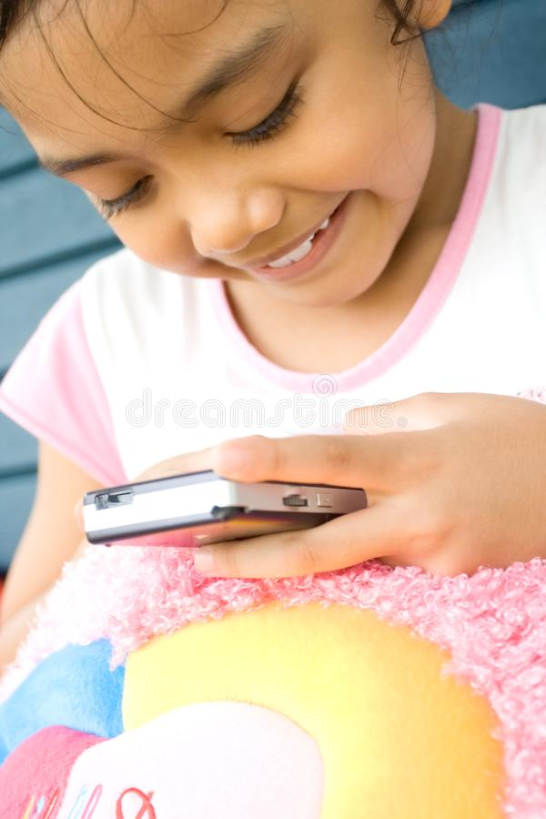 Download Little girl with cellphone stock photo. Image of asian - 9435116