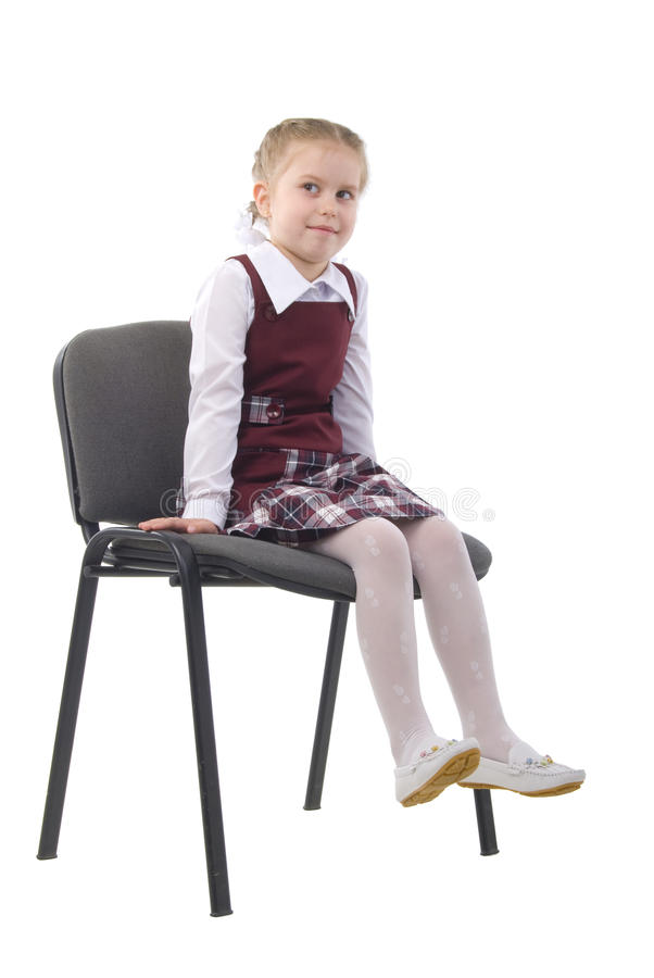 little girl on a chair stock photo image 10088750. Black Bedroom Furniture Sets. Home Design Ideas