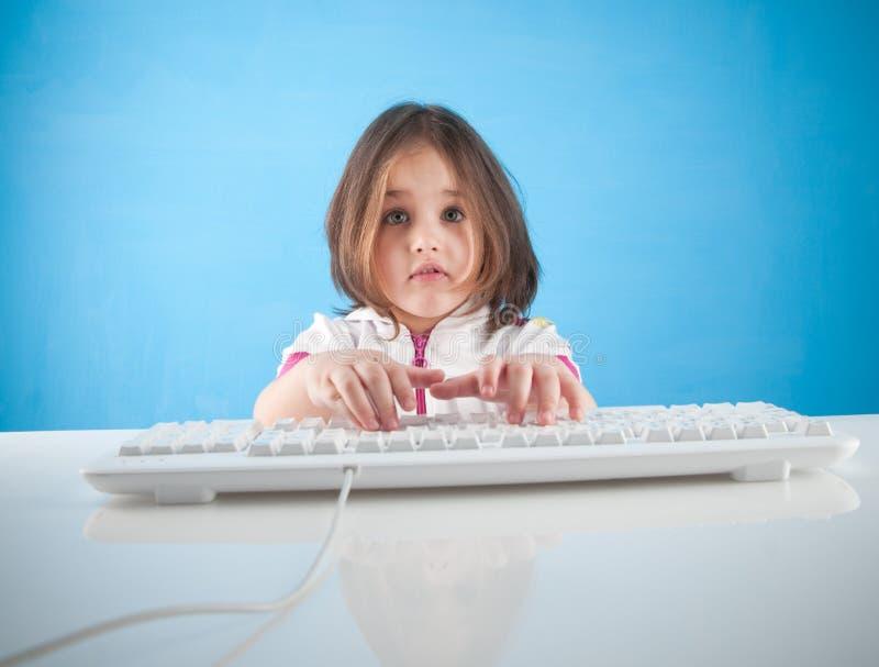 Little girl chatting. A little girl chatting in internet stock image