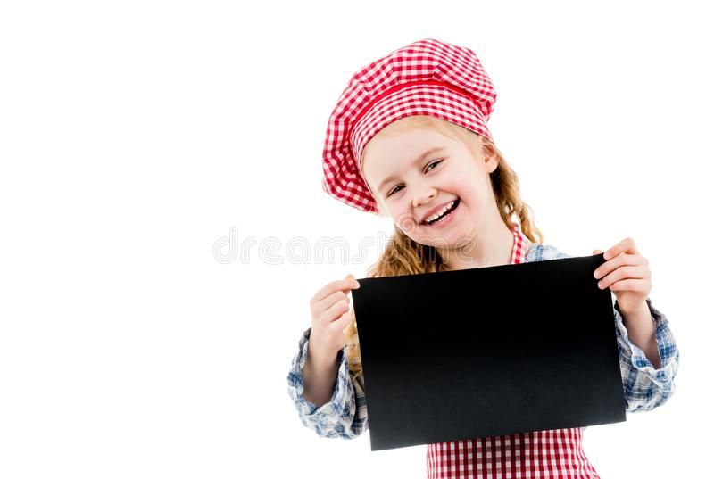 Little girl in chef uniform with blank paper stock photos