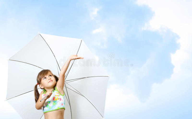 Little girl child. With umbrella on sky background stock image