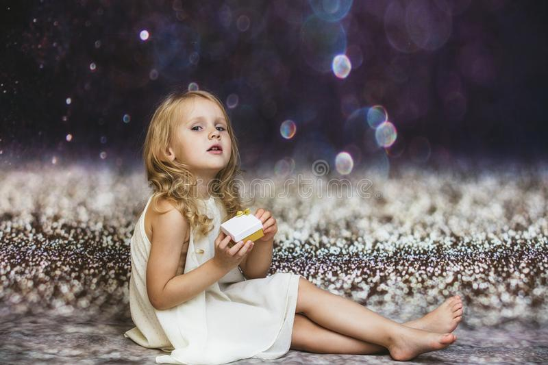 Little girl child cute and beautiful in the background with a gl royalty free stock image