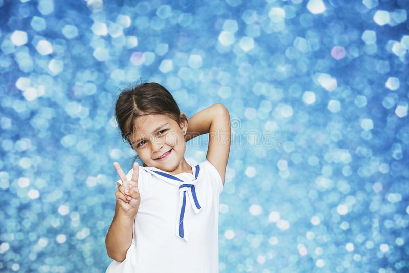 Little girl child cute and beautiful background glare happy happ royalty free stock photography