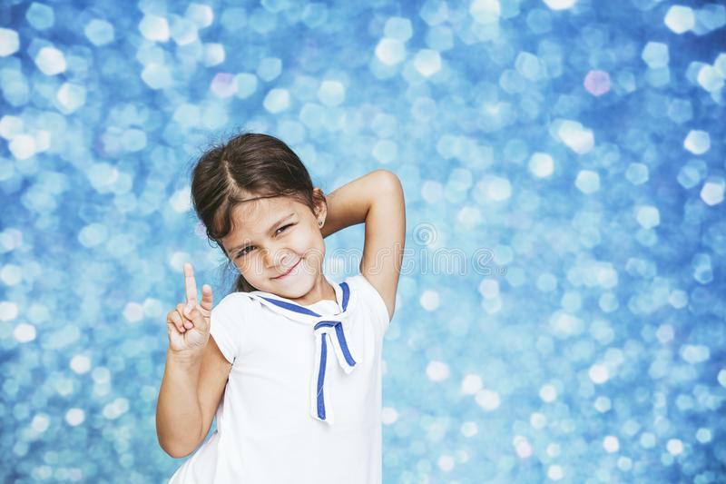 Little girl child cute and beautiful background glare happy happy stock image