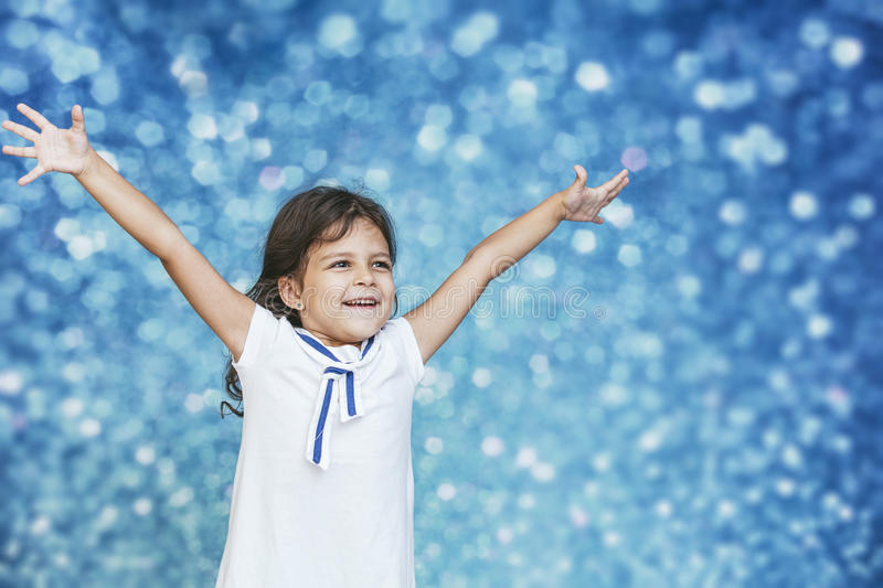 Little girl child cute and beautiful background glare happy happy stock photo