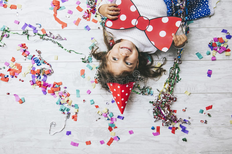 Little girl child cute and beautiful with multi-colored confetti stock photos