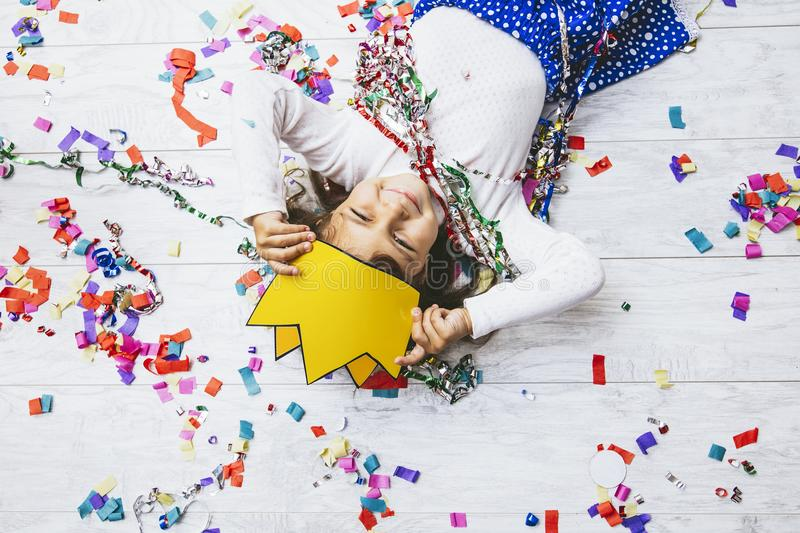 Little girl child cute and beautiful with multi-colored confetti royalty free stock photos