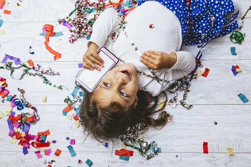 Little girl child cute and beautiful with multi-colored confetti stock photography