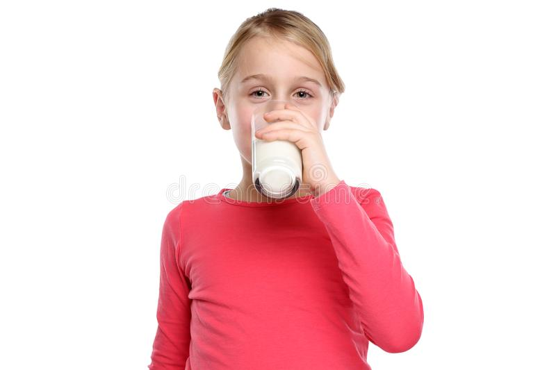 Little girl child drinking milk kid glass healthy eating isolate. D on a white background stock photos