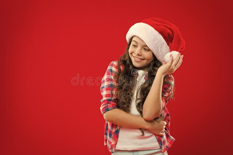Little girl child in santa hat. Christmas shopping. Happy winter holidays. Small girl. Present for Xmas. Childhood. New stock image