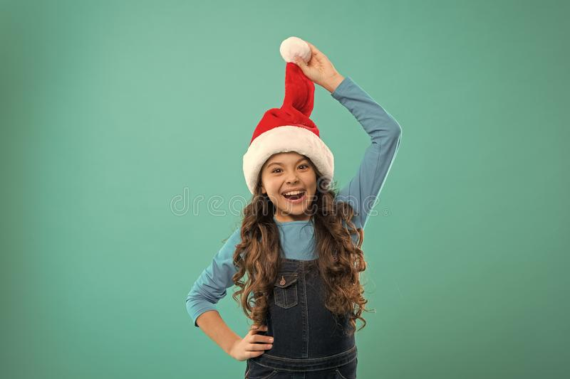 Little girl child in santa hat. New year party. Santa claus kid. Happy winter holidays. Small girl. Present for Xmas royalty free stock photography