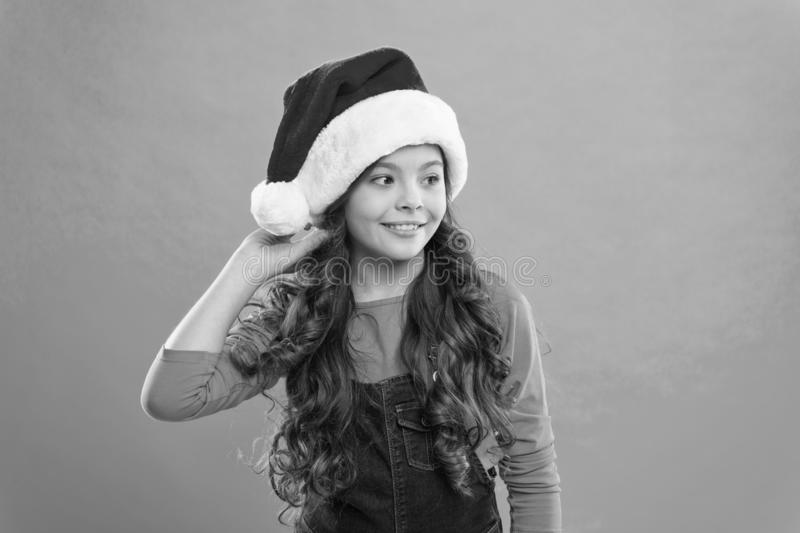 Little girl child in santa hat. Present for Xmas. Childhood. New year party. Santa claus kid. Happy winter holidays stock photography