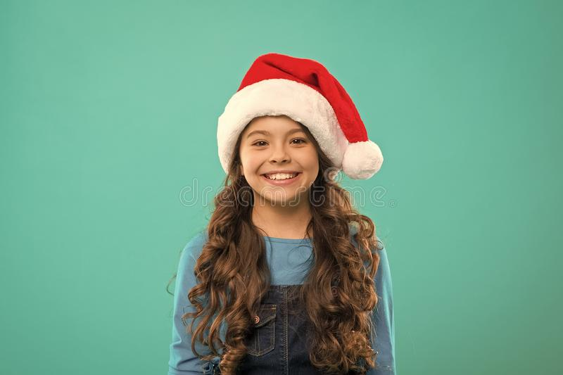Little girl child in santa hat. Present for Xmas. Childhood. New year party. Santa claus kid. Happy winter holidays royalty free stock image