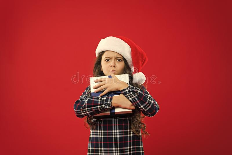 Little girl child in santa red hat. Christmas shopping. Happy winter holidays. Small naughty girl. Present for Xmas. Childhood. New year party. Santa claus kid stock photography
