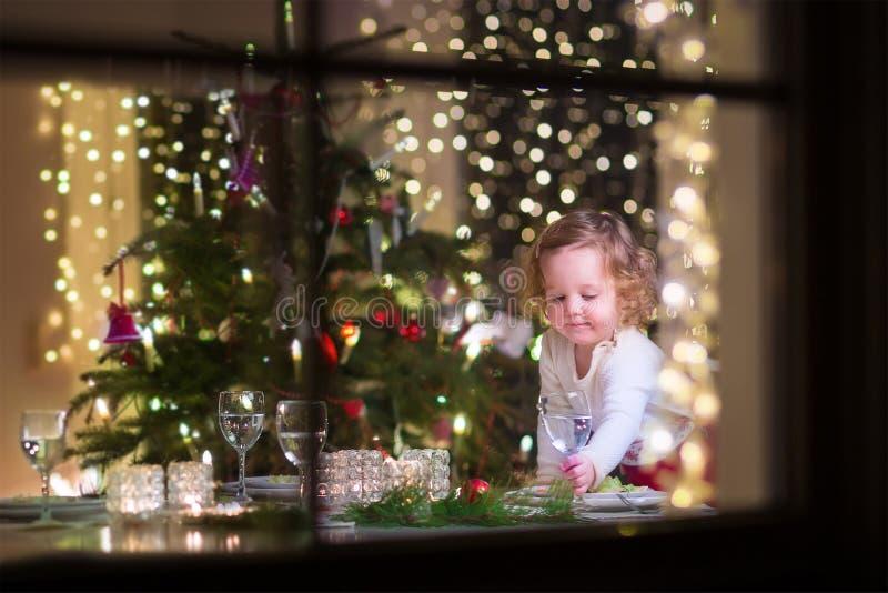 Little girl at Christmas dinner royalty free stock images