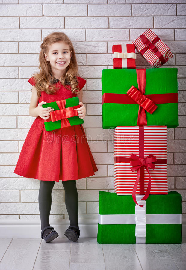 Little girl with Christmas gifts royalty free stock photography