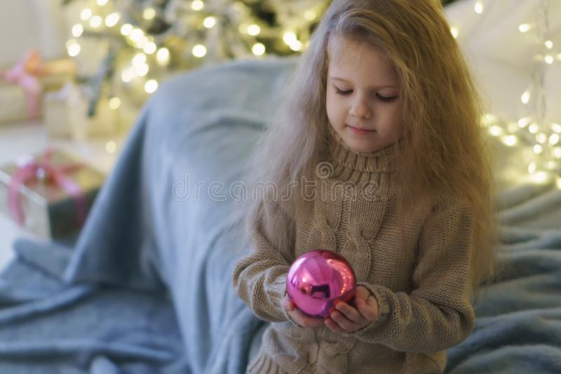 Little girl with christmas toy. stock photography